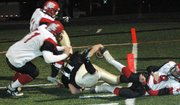 Turner quarterback Richie Blazevic stretches for the goal line during the second half.