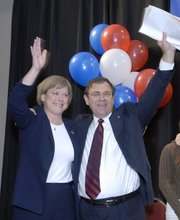 Democrat Nancy Boyda and her husband and campaign manager, Steve Boyda, celebrate her victory over Republican incumbent Jim Ryun in the race for the 2nd District Congressional seat.