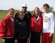 Errol Logue, Lansing High cross country coach, spends a moment with state qualifiers, from left, Lori Flippo, Abbey Lozenski, Lauren Jaqua and Brandon Craig at the Class 5A state meet on Oct. 28. Of those qualifiers, Lozenski, Jaqua and Craig are freshmen.