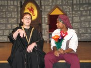 "Wizard (Russell Buchanan), left, and Minstrel (Brandon Mills) rehearse a scene from ""Once Upon a Mattress."" Lansing High School will present the play at 7 p.m. Friday and Saturday, Nov. 17 and 18, in the Lansing Intermediate School auditorium. The musical was inspired by Hans Christian Andersen's fairy tale ""The Princess and the Pea."""