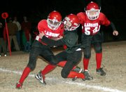 The Lansing Red Bulls and Lansing Blackhawks compete in the fifth- and sixth-grade Super Bowl on Nov. 11.