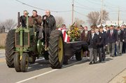 Moving at a slow step, the cortege for Bob Wiley's funeral consisted of area VFW members and firefighters from Fairmont Township. The tractor pulling the casket was driven by Gale Knoche with Charlie Bates and Charlie Peterson, all old friends of Wiley's.