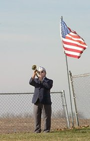 From a quiet corner of Glenwood Cemetery, Jeral Cooper of Basehor Post 11499 played taps.