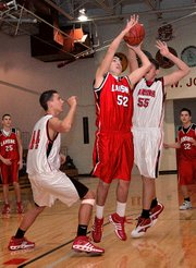 Lansing High junior P.J. Sigle puts up a shot in the lane Tuesday night during the Red-White Scrimmage.