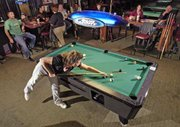 "Keleigh Scheuermann, Lansing, shoots the six ball during a game at Side Pockets in Bonner Springs. Scheuermann and three other women on the team, ""4 Squaws,"" play pool together every Tuesday and Wednesday night."