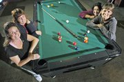 There may be fewer women than men who are serious pool players in competitive leagues. Yet these women, who play pool together, who cheer each other on, and who continue to rack up the points, are confident and comfortable at the pool tables. Pictured clockwise from lower left are, Keleigh Scheuermann, Lin Davis, Nicolette Ducey and Terry Mitchener. The women also have careers and interests outside the pool hall. Scheuermann makes pottery, Davis is an analyst for Sprint Nextel, Ducey works at an Olathe dental lab where she's immersed in the intricacies of making crowns and bridges, and Terry works for Holliday Sand and Gravel in Bonner Springs.