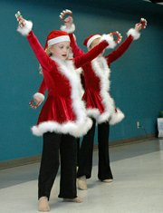 Matilian Cassmeyer performs with other dancers from Katie's Dance Studio at the Mayor's Christmas Tree Lighting.