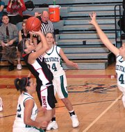 Lansing High junior Morgan Chiles puts up a jumper in the lane during the fourth quarter against Free State.