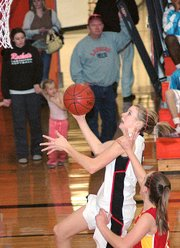 Lansing High sophomore Brittney Lang goes up for a layup during Lansing's victory over Atchison.