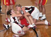 Lansing High's Christine Cordes, left, and Amanda Darrow scrap for a loose ball during Lansing's victory over Atchison.