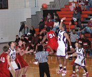 Lansing High senior Jeff Jackson wins the opening tip against Bishop Miege's Travis Releford. The jump ball marked the start of the 2006-2007 season.