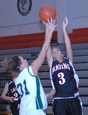 Lansing High junior forward Morgan Chiles puts up a shot against Lawrence Free State.