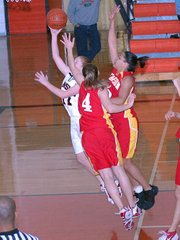 Lansing High freshman Amy Briggs glides past the Atchison defense for a layup.