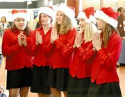 "Eighth-grade choir members Sara Marquez, Dotty Harrison, Shelbie Todd, Lacey Erickson and Brandie Garrett sing ""Santa Baby"" at the Sears Grand store in Lenexa. The eighth-grade choir at Lexington Trails Middle School performs at 7 p.m. Tuesday at the seventh- and eighth-grade choir concert at LTMS, 8800 Penner Avenue, and Dec. 21 at Hillside Village of De Soto, 33600 W. 85th St."