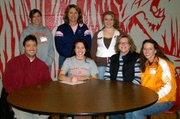 Riann Deere, Lansing High senior, signed a letter-of-intent on Dec. 7 to play volleyball at Neosho County Community College. Pictured at the signing ceremony are, front row, from left: Kyle Deere, Riann Deere, Debbie Deere, Neosho head coach Lindsay Sowder. Back row: Neosho assistant coach Asya Herron, LHS volleyball coach Julie Slater and Taylar Deere.