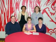 Jessie Delinger, Lansing High senior, signed her letter-of-intent Dec. 8 to play volleyball at Coffeyville Community College. Pictured at the signing ceremony are, from left, front row: Merle Delinger, Jessie Delinger and Janette Delinger. Back row: Coffeyville coach Delice Downing and LHS coach Julie Slater.