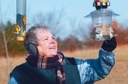 Dorothy Tolman fills a bird feeder in her front yard in rural Tonganoxie.