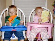 The Toedter twins inspect the birthday cards they received during their birthday party. Langston, left, and Kendall were showered with cards, gifts and plenty of hugs and kisses Saturday in celebration of their 1st birthdays.