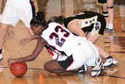 Lansing High senior Chanel Johnson comes up with a loose ball Friday night during Lansing's 63-44 victory over Turner.
