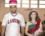 Lansing High School seniors Jeff Jackson, left, and Bianca Manago were crowned Winter Royalty king and queen on Friday night at halftime of the LHS boys basketball game against Turner.