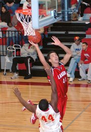 Lansing High junior Stephen Didde goes up for a shot Monday against Atchison.