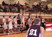 The Lansing High bench erupts in celebration after Curtis Beall hit the game-winning three-pointer with a half-second remaining against Silver Lake.