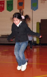 Second-grader Lexi Simmons practices for the Jump Rope for Heart event at Lansing Elementary School.