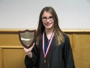 Leavenworth County Spelling Bee champ Molly Oberstein-Allen shows off the plaque she won.