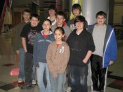 Yellow ribbons in the commons area at Lansing Middle School remind these students of loved ones who have been deployed overseas. Front row: Alison Davila. Second row, from left: Alyssa Glowacki and Sam Anderson. Third row: Geno DeGraw, Tanner Sherman and Matthew Bessasparis. Fourth row: Brandon Glowacki, Nick Fodness and Matt Newby.