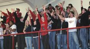 The Lansing High student section celebrates after Tonganoxie's last-second shot sailed long and LHS hung on for a 42-41 victory.