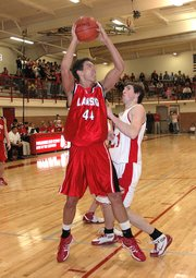 Lansing High sophomore Stephen Didde goes up for two points during the first quarter Friday night against Tonganoxie.