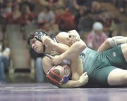 De Soto junior Tom Beaver grabs the momentum and works to pin Santa Fe Trails' Joey Elliott Friday in the regional wrestling tournament. Beaver wasn't able to finish Elliott off and eventually lost the match.