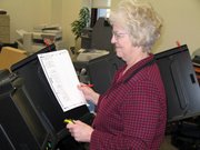 County Clerk Linda Scheer conducts a test on as voting machine ahead of Tuesday's primary election.