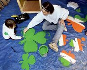 With a little luck of the Irish and a lot of paint, Sarah Book of Shawnee and her 2-year-old daughter Frankie were getting the color shamrocks ready in preparation for the St. Patrick's Day Parade in downtown Kansas City.