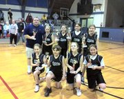 The Lansing girls placed second in the annual Lansing-Leavenworth Tournament on Sunday at Lansing Activity Center. Team members are, front row, from left: Abby Hilliard, Katie Parks, Kaitlyn Pettis, Jena Hinkley. Second row: Coach Bryan Pettis, Taylor Martin, Ashley Linaweaver, Kelly Miracle and Renee Johnson.