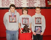 Slammer Wrestling Club members, from left, Zach Hammer, Tyler Baughman and Nathan Wessel were top performers at the Liberty Nationals on Feb. 24.