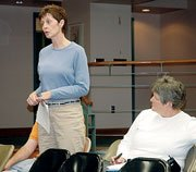 Baldwin School District Patron Joanne Kite outlines problems at Baldwin Elementary School Primary Center at Monday's meeting. At right is BESPC Principal Deb Ehling-Gwin.