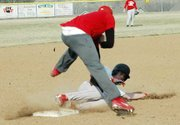 John Sebes, Lansing High senior, slides under the tag of Shay Goodnature at third base during the Red-White Scrimmage.