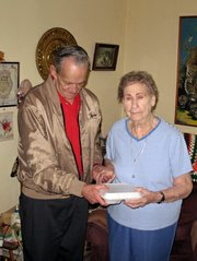 Mayor Kenneth Bernard delivers a Meals on Wheels meal to Genevieve Krebs. Bernard helped deliver 25 meals Wednesday.
