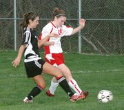 Lansing High sophomore defender Kathryn Sebes breaks up a Blue Valley West attack during the first half Thursday.