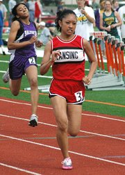 Lansing High sophomore Michelle Collins competes in the 100-meter dash at the Baldwin Invitational.