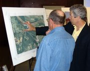 Tom Schrempp, right, Johnson County Water District No. 1's director of production, describes the utility's expansion plans to an area resident on Thursday, March 29 at an informational meeting in Lansing. WaterOne wants to build a water treatment plant south of Lansing on Kansas Highway 5.