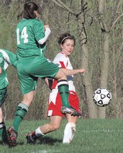 Lansing High senior Bianca Manago sneaks a shot past an Immaculata defender. Manago scored two goals in Lansing's 10-0 victory.