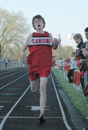 Lansing High freshman Brandon Craig crosses the finish line after pulling away to win the 1,600-meter run on Tuesday at the Lansing Invitational.