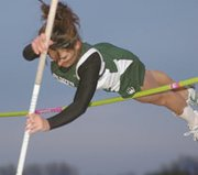 De Soto's Cheyenne Williams tries to clear the pole vault bar Thursday at the Mill Valley Invitational track meet. Williams won the event by clearing 7-foot-6. She just missed on a bid to earn the school record moments later, missing three times at 8-2.