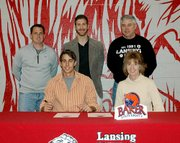 Alex Burton, Lansing High senior, signed a letter-of-intent on Thursday, April 5, to play soccer at Baker University. Pictured at the signing ceremony are, front row, from left: Alex Burton and Paula Burton; and second row: club coach Jon Parry, Baker assistant Clint Schneider and LHS head coach Randy Brown.