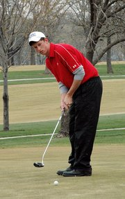 Lansing High senior Ryan Willcott knocks down a putt at the Lansing Invitational.