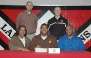 Lansing High senior Jeff Jackson signed a letter-of-intent on Tuesday, April 17, to play basketball at Fort Scott Community College. Seated next to him at his signing ceremony are his parents, Joyce and Rick Jackson. Standing are LHS assistant coach Ben Doll, left, and LHS head coach Rod Briggs.