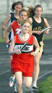 Lansing High freshman Sarah Nielsen competes Friday during the 3,200-meter relay at the Gardner Invitational. LHS placed fourth in the event.