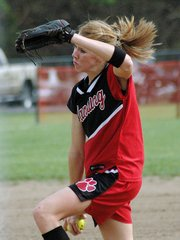 Lansing High sophomore Brittney Lang fires a pitch during Monday's doubleheader against Tonganoxie.